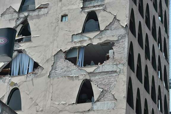 Picture of the damages caused on a building by a powerful quake in Mexico City on September 19, 2017. A powerful earthquake shook Mexico City on Tuesday, causing panic among the megalopolis' 20 million inhabitants on the 32nd anniversary of a devastating 1985 quake. The US Geological Survey put the quake's magnitude at 7.1 while Mexico's Seismological Institute said it measured 6.8 on its scale. The institute said the quake's epicenter was seven kilometers west of Chiautla de Tapia, in the neighboring state of Puebla.  / AFP PHOTO / Yuri CORTEZYURI CORTEZ/AFP/Getty Images