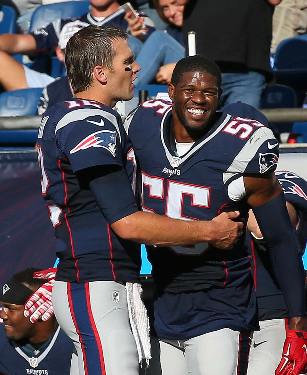 FOXBORO, MA - SEPTEMBER 27: Tom Brady #12 of the New England Patriots celebrates with Jonathan Freeny #55 of the New England Patriots at the end of a game against the Jacksonville Jaguars at Gillette Stadium on September 27, 2015 in Foxboro, Massachusetts. (Photo by Jim Rogash/Getty Images)