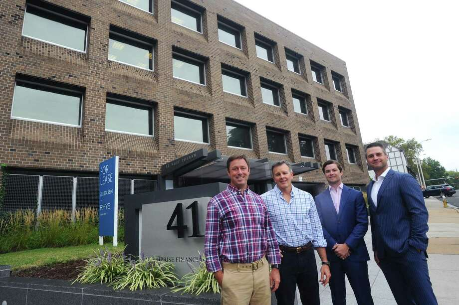 From left, Ivy Equities Chief Investment Officer David Archibald, Ivy Equities Co-Chief Executive Officer Rusty Warren Jr., Rhys Commercial Managing Director Sam Chambers and Rhys Commercial Executive Vice President Christian Bangert pose for a photo outside their West Putnam Avenue office building in Greenwich, Conn. on Wednesday, Sept. 6, 2017. Photo: Michael Cummo / Hearst Connecticut Media / Stamford Advocate