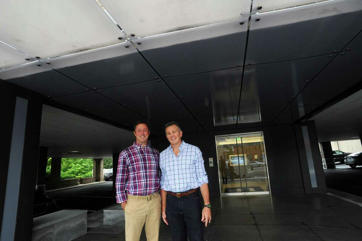 Ivy Equities Co-CEO Rusty Warren Jr., center, and Chief Investment Officer David Archibald pose for a photo outside their West Putnam Avenue office building in Greenwich, Conn. on Wednesday, Sept. 6, 2017.