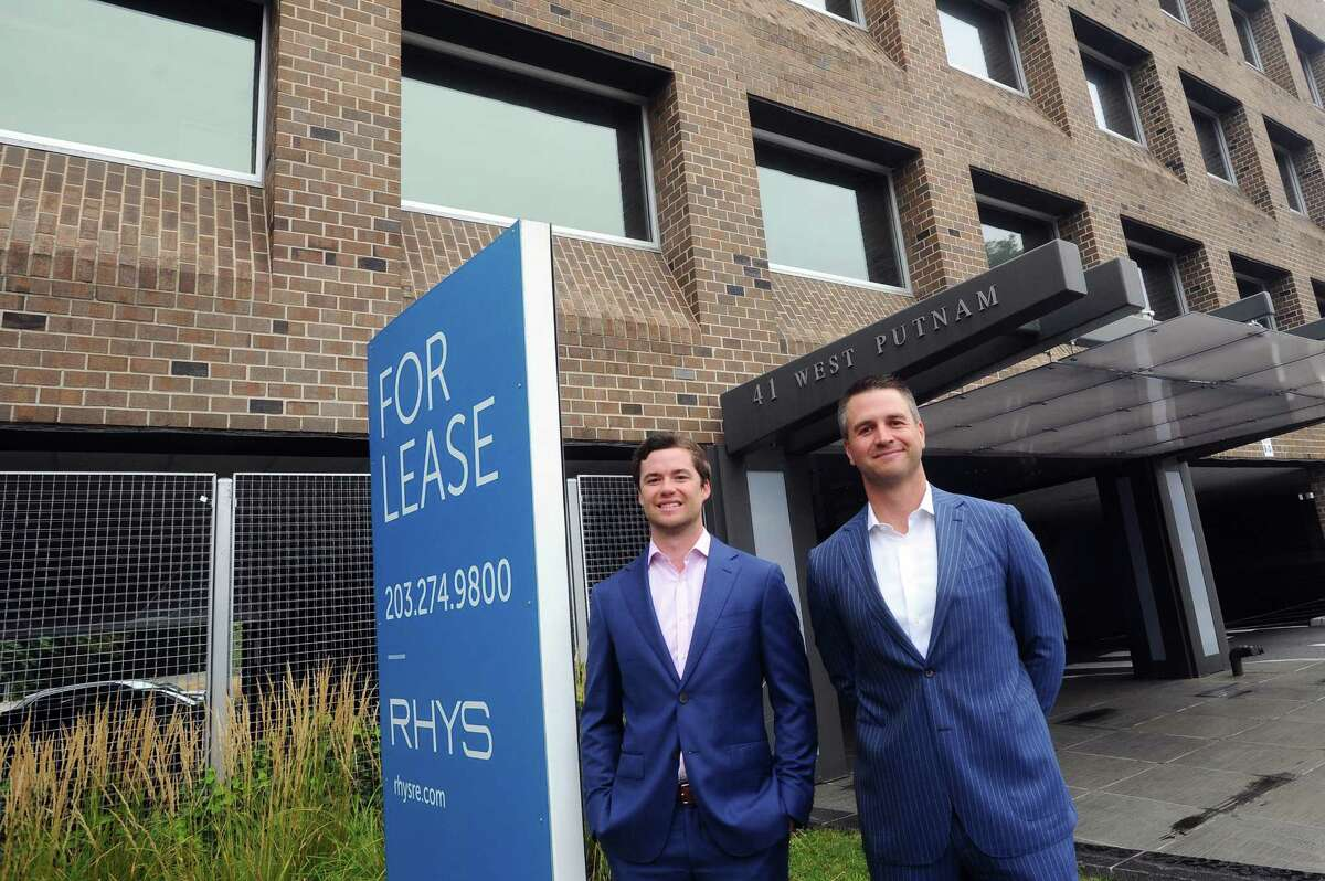 Rhys Commercial Managing Director Sam Chambers, left, and Executive Vice President Christian Bangert pose for a photo outside their West Putnam Avenue office building in Greenwich, Conn. on Wednesday, Sept. 6, 2017.