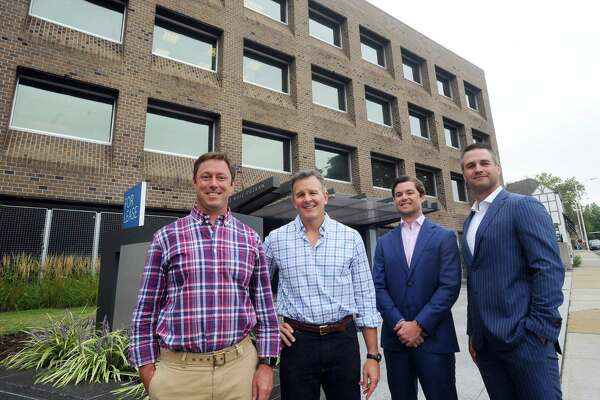 From left, Ivy Equities Chief Investment Officer David Archibald, Ivy Equities Co-Chief Executive Officer Rusty Warren Jr., Rhys Commercial Managing Director Sam Chambers and Rhys Commercial Executive Vice President Christian Bangert pose for a photo outside their West Putnam Avenue office building in Greenwich, Conn. on Wednesday, Sept. 6, 2017.