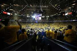 Confetti rains down on the court after the Golden State Warriors defeated the Cleveland Cavaliers 129-120 in Game 5 of the NBA Finals at Oracle Arena in Oakland, Calif., on Monday, June 12, 2017, to become NBA Champions for the second time in three years.