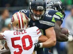 Seahawks corner back Justin Coleman blocks 49ers linebacker Brock Coyle from running back Chris Carson in the first half at CenturyLink Field on Sunday, Sept. 17, 2017. (GRANT HINDSLEY, seattlepi.com)