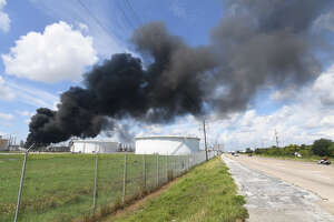 Smoke and fire rise from a heavy oil tank at Valero's Port Arthur facility on Wednesday. No injuries were reported in the incident. Area residents were asked to shelter in place by city officials. Photo taken Wednesday, September 19, 2017 Guiseppe Barranco/The Enterprise