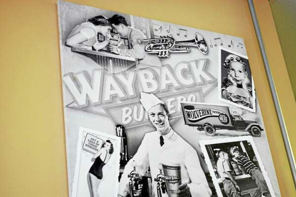 Vintage photographs adorn the walls of Wayback Burgers in Middletown's Metro Square.