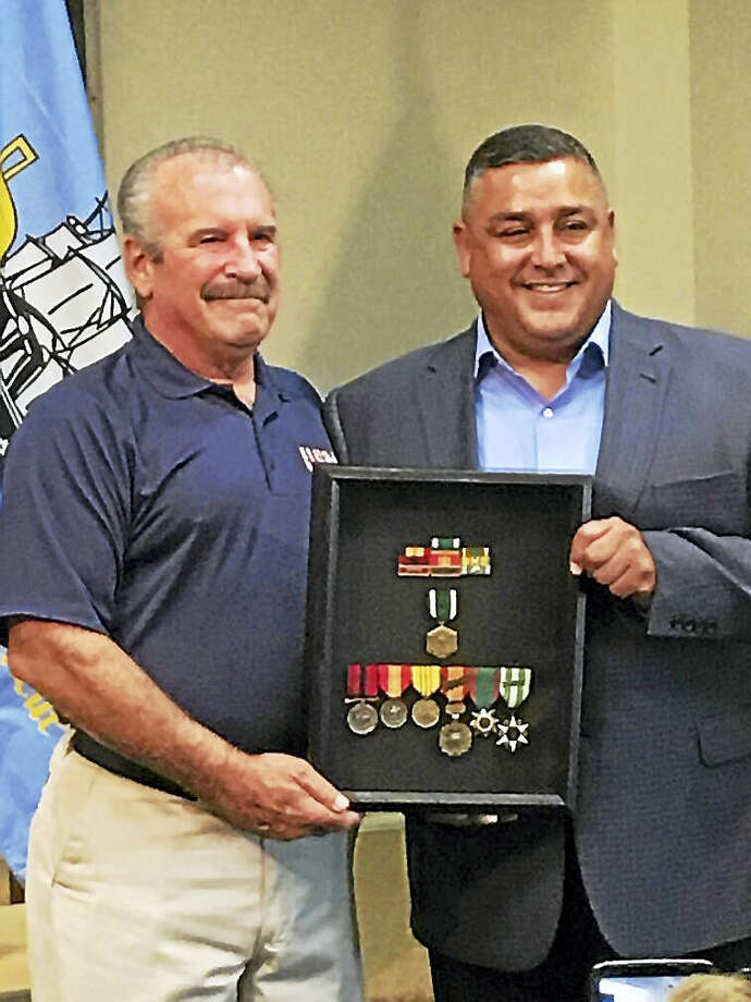 U.S. Rep. Joe Courtney presented Robert Olivieri of East Hampton with medals earned during his service in U.S. Marine Corps from July 1965 to 1969 Thursday at the East Hampton Public Library. Photo: Courtesy Olivieri Family