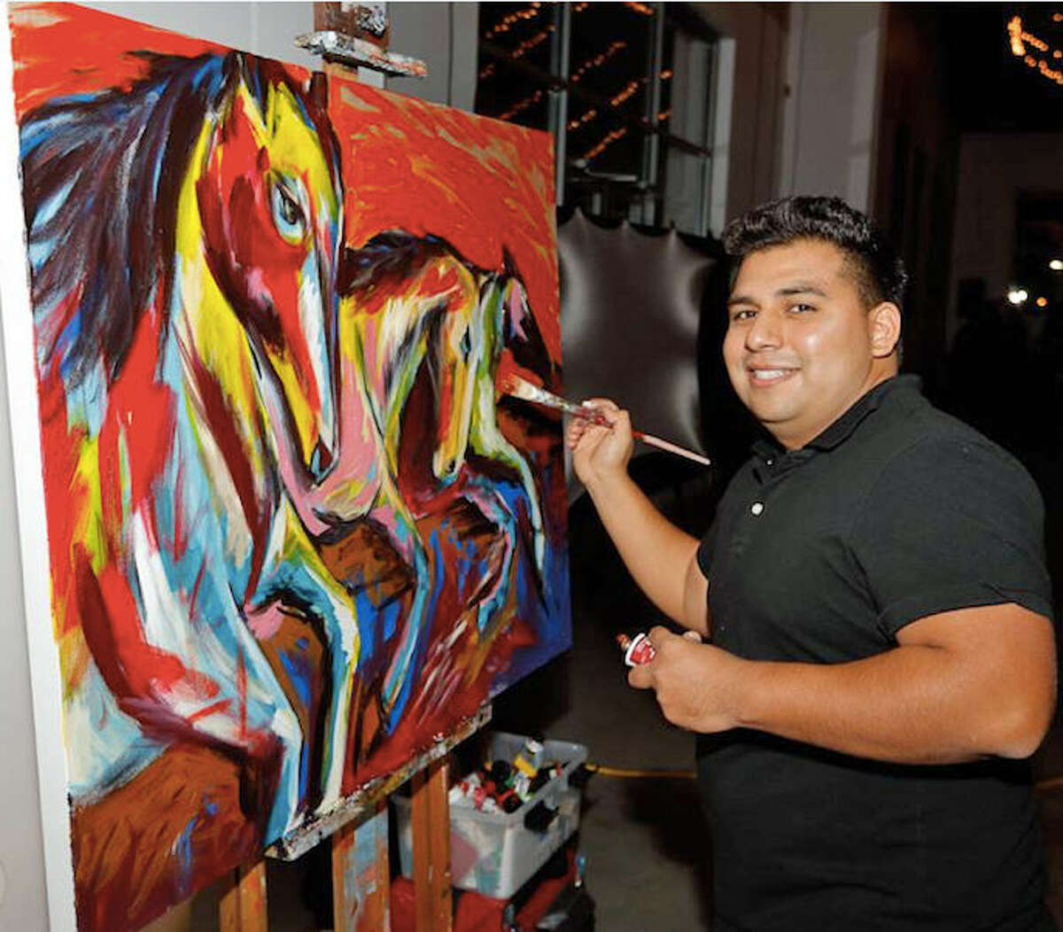 Mark Deleon works on a painting that will be exhibited at the Harvest Green Farmhouse, 3400 Harvest Corner Drive, through Oct. 20. The public can meet the artist at a reception 6-8 p.m. Thursday, Sept. 21.