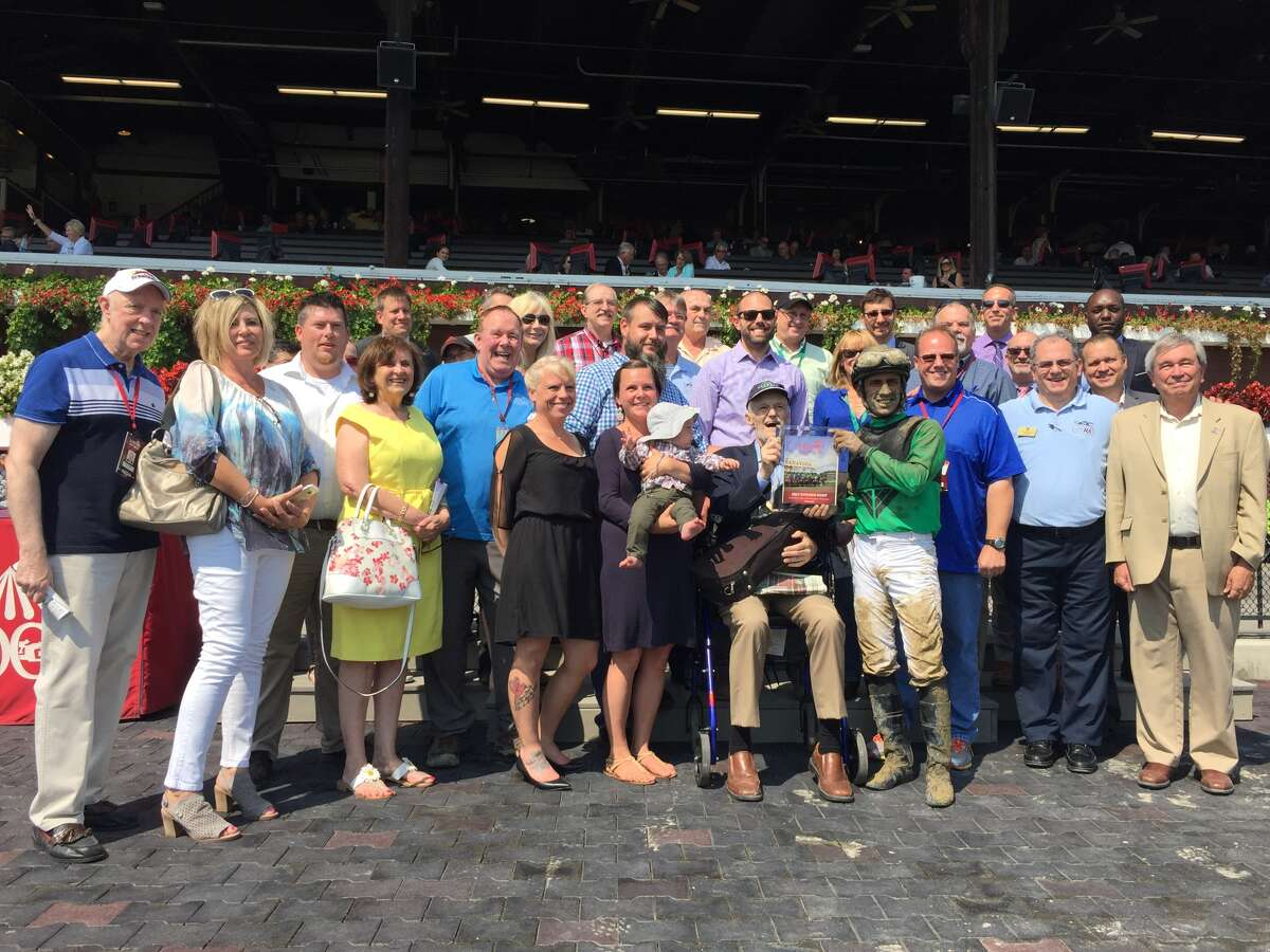 Times Union's Mike Jarboe, a horse racing handicapper for the newspaper, is surrounded by friends and family in the winner's circle after a race named in his honor at Saratoga Race Course on September 4, 2017. (Joyce Bassett / Times Union)