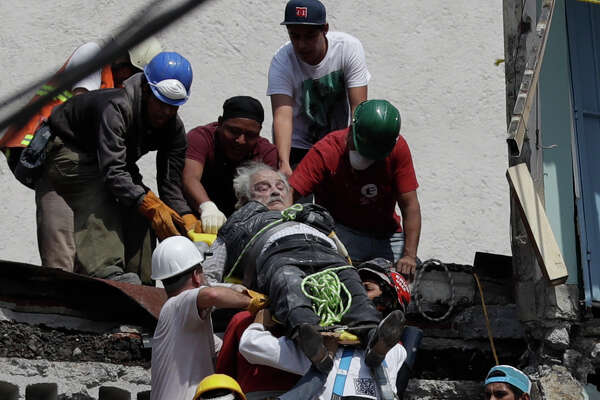 An injured man is pulled out of a building that collapsed during an earthquake in Mexico City, Tuesday, Sept. 19, 2017. A powerful earthquake jolted central Mexico on Tuesday, causing buildings to sway sickeningly in the capital on the anniversary of a 1985 quake that did major damage.