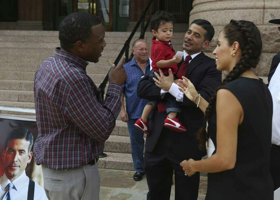 """Bexar County District Attorney Nicholas """"Nico"""" LaHood holds his youngest son, Zaiter, on Sept. 19, 2017 outside the Bexar County Courthouse as he talks to supporters after announcing his re-election bid. LaHood's wife, Davida, stands at right. Photo: William Luther /San Antonio Express-News / © 2017 San Antonio Express-News"""