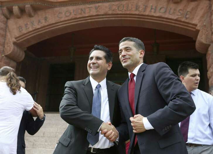 "Manuel Medina, left, shakes hands Tuesday, Sept. 19, 2017 outside the Bexar County Courthouse with Bexar County District Attorney Nicholas ""Nico"" LaHood after LaHood announced his re-election bid."