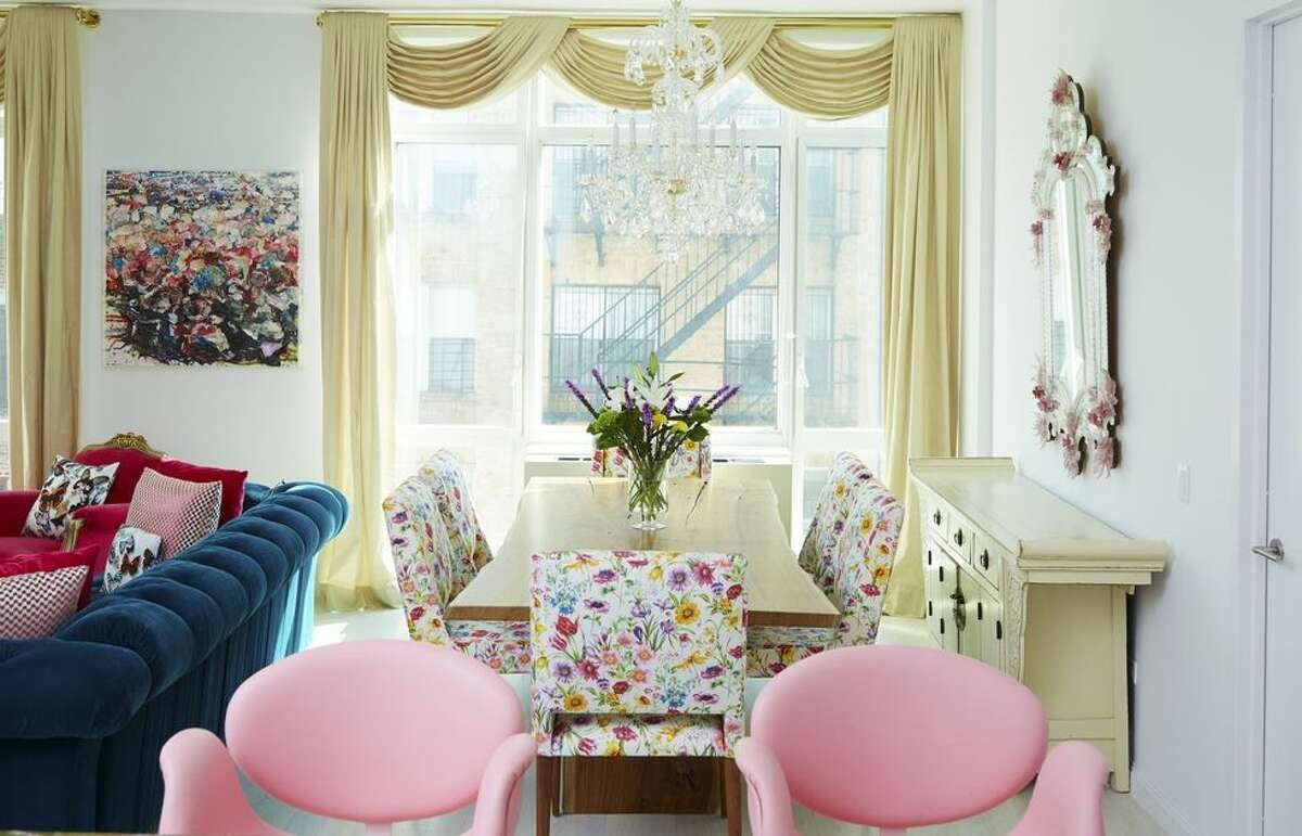 """1) Create A """"Bouquet"""" Of Colors: Want to make a variety of bright colors cohesive? Think about how youwould arrange aflower bouquet, as Sasha Bikoff didin this SoHo apartment.""""The same can apply to a space, but you need to find a connection,"""" she says. """"Here, that connection is the fabric on the dining room chairs, which showcases colors also found throughout the room."""""""