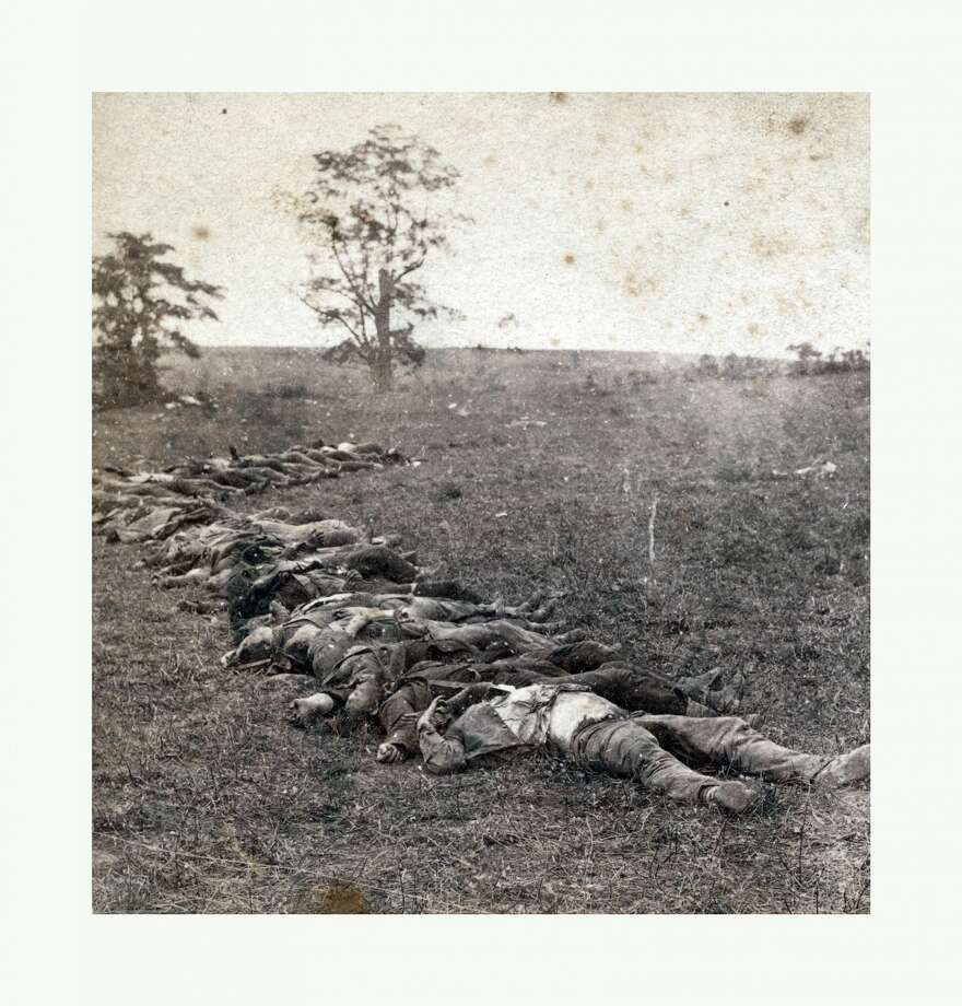American Civil War: Gathered together for burial after the Battle Of Antietam, dead bodies on the ground. P Photo: Universal History Archive/UIG Via Getty Images
