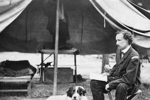 Lieutenant George A. Custer with Dog, Peninsula Campaign, Virginia, USA, 1862.