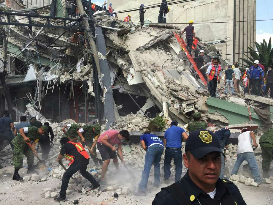People search for survivors in a collapsed building in the Roma neighborhood of Mexico City, Tuesday, Sept. 19, 2017. A powerful earthquake has jolted Mexico, causing buildings to sway sickeningly in the capital on the anniversary of a 1985 quake that did major damage. Photo: Enric Marti, AP / Copyright 2017 The Associated Press. All rights reserved.