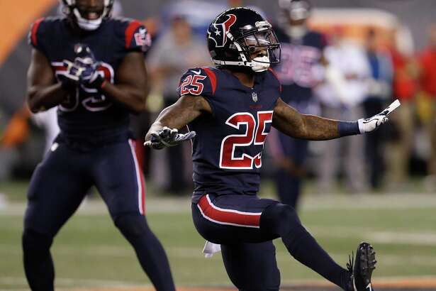 Houston Texans cornerback Kareem Jackson (25) celebrates after sacking Cincinnati Bengals quarterback Andy Dalton during the first quarter of an NFL football game at Paul Brown Stadium on Thursday, Sept. 14, 2017, in Cincinnati. ( Brett Coomer / Houston Chronicle )