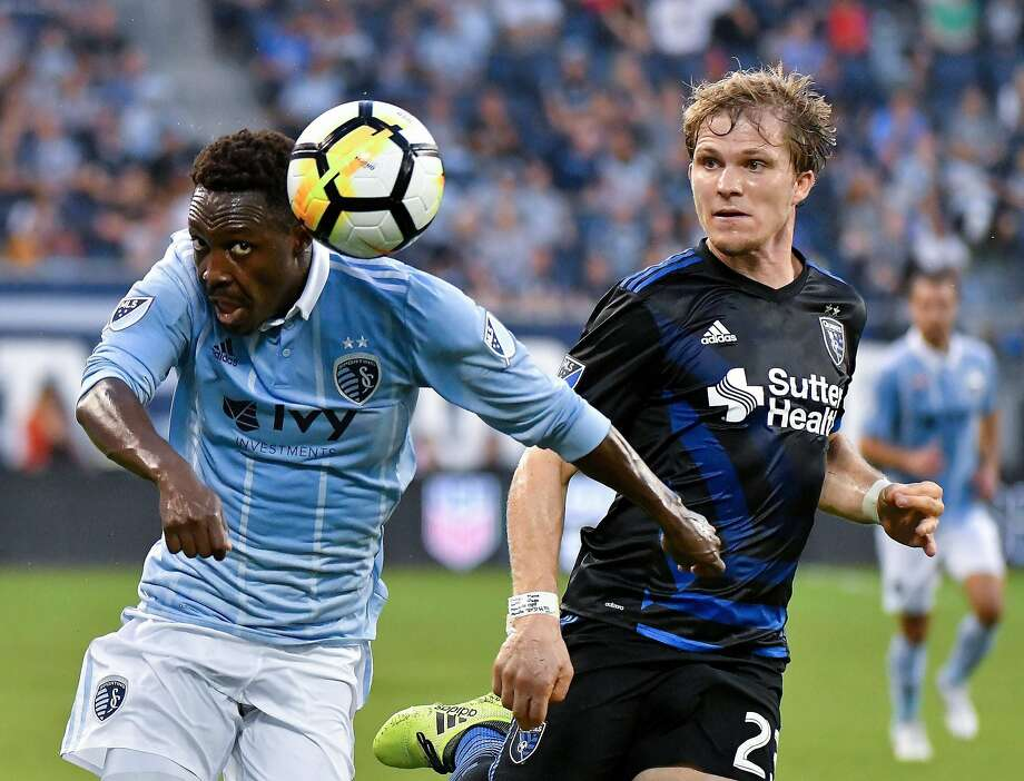 Sporting KC forward Gerso Fernandes directs the ball past Earthquakes midfielder Florian Jungwirth last month. Photo: John Sleezer, Associated Press