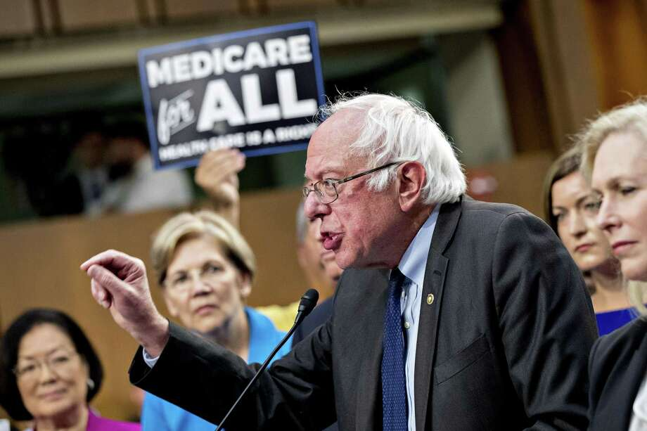 "Sen, Bernie Sanders, an independent from Vermont, speaks last week on his ""Medicare for all"" bill, to which many congressional Democrats thought to be vying for the presidency flocked. Democrats need to truthfully explain how we get to single payer. It involves painful choices. Photo: Andrew Harrer /Bloomberg / © 2017 Bloomberg Finance LP"
