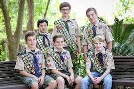 Boy Scouts, from the left: Jarrett Kotalik, Edward Poon, Rafe Kotalik, Noah Kotalik, Brock Romanski, Gage Maddox pose for a photo on Sunday, Sept. 17, 2017, at The Woodlands Community Presbyterian Church.
