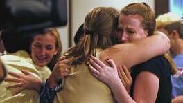 Peyton Spriester, 17, is hugged by fellow student Kathryn Courtney, 16, after board voted to change the name of Robert E. Lee HS in August.