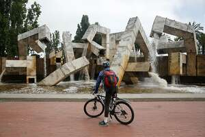 Mikko Miller of Burlingame takes in the view of Vaillancourt Fountain as water flows from it at Justin Herman Plaza on Tuesday, August 15, 2017 in San Francisco, Calif. Miller was riding by during his commute and said he hasn't seen water flowing from it for a long time.