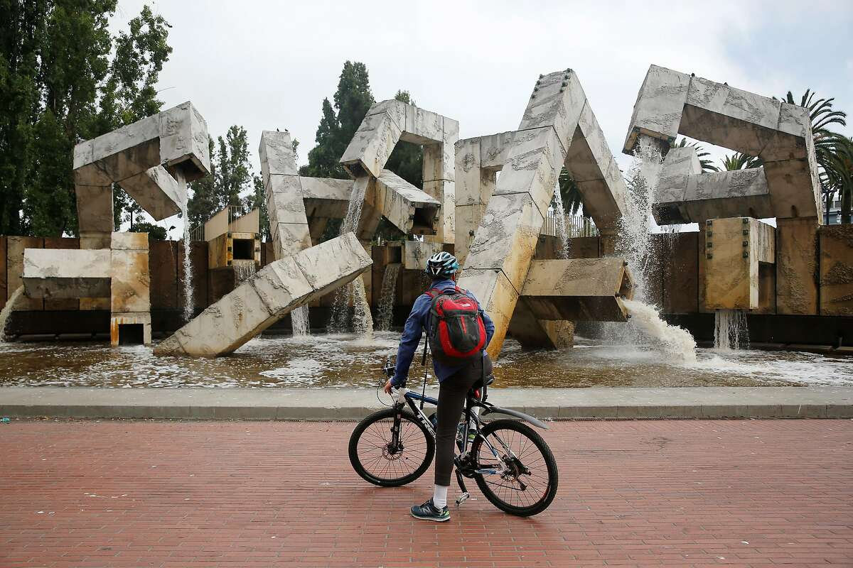 Mikko Miller of Burlingame takes in the view of Vaillancourt Fountain as water flows from it at Justin Herman Plaza on Tuesday, August 15, 2017 in San Francisco, Calif.