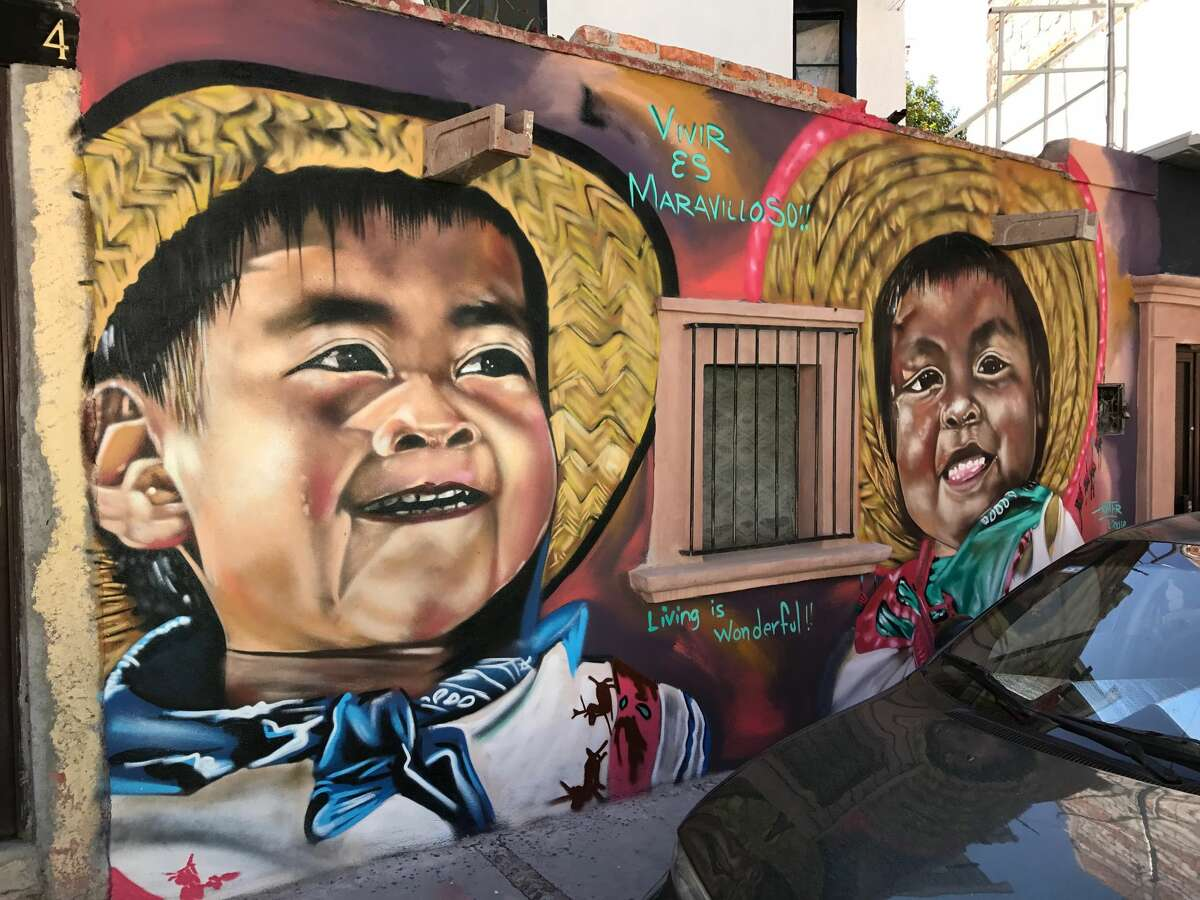 Colorful murals are found on the sides of buildings on the Guadaloupe colonia of San Miguel de Allende.