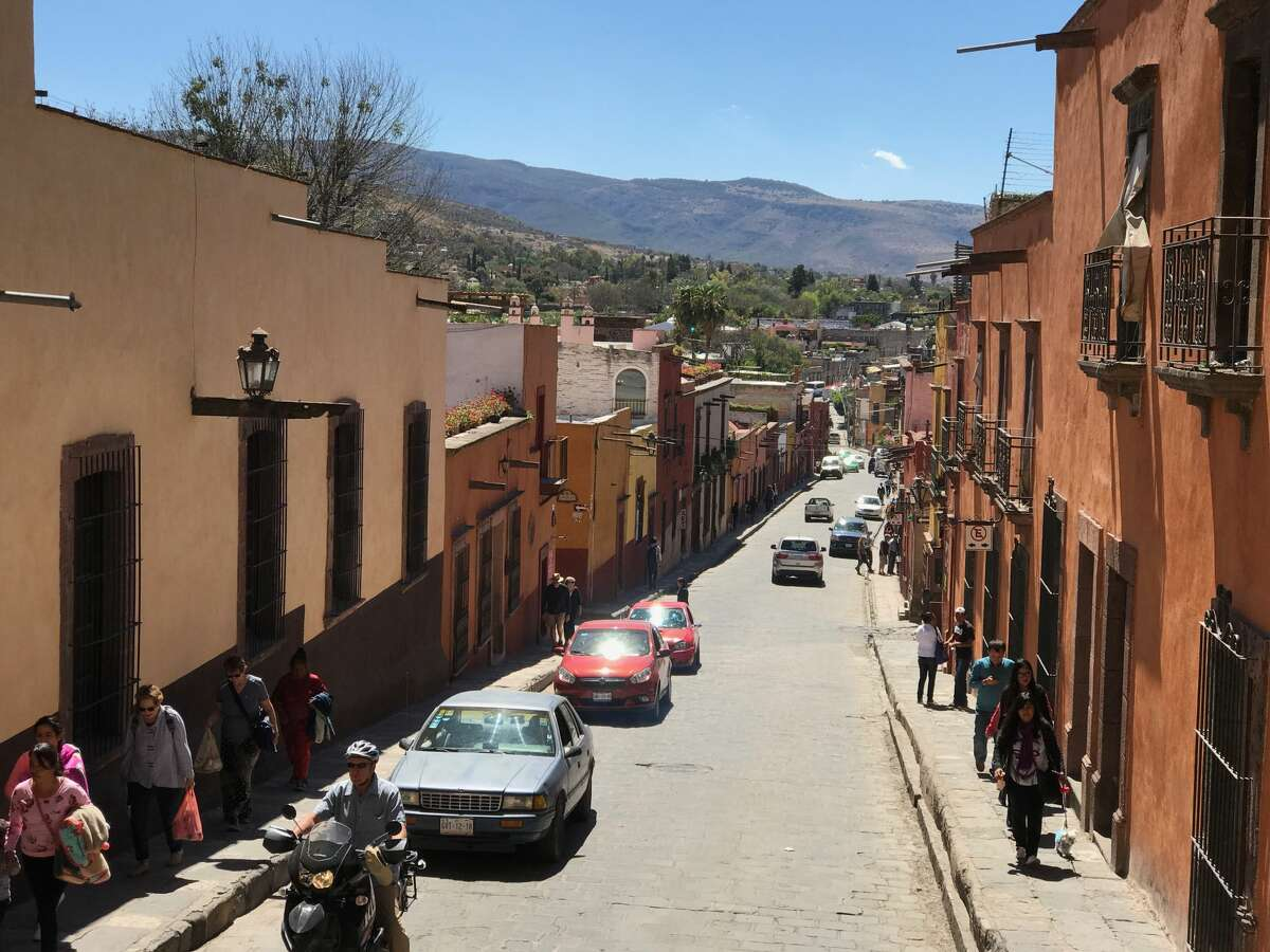 San Miguel's narrow sidewalks, cobblestone streets and colorful buildings typify colonial Mexican towns.