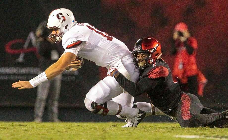 San Diego State's Kameron Kelly sacks Stanford's Keller Chryst on Saturday night. Chryst went 8-for-19  with two  interceptions and a lost fumble in the Cardinal's 20-17 loss. Photo: Hayne Palmour IV, TNS