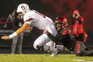Stanford quarterback Keller Chryst is sacked by San Diego State's Kameron Kelly, right, in the second quarter at Jack Murphy Stadium in San Diego on Saturday, Sept. 16, 2017. (Hayne Palmour IV/San Diego Union-Tribune/TNS)