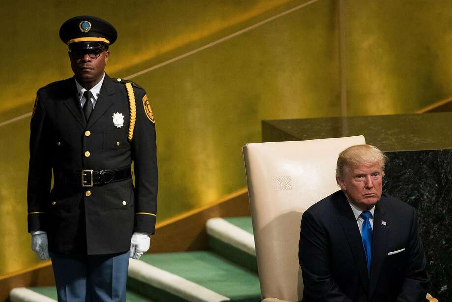 President Trump  waits to be escorted from the stage after addressing the U.N. General Assembly on Tuesday in New York. Trump's speech alarmed some with its bellicose rhetoric. Photo: Drew Angerer, Getty Images