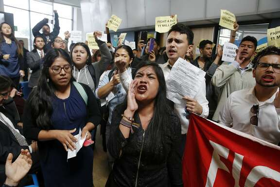 Protesters yell as U.S. Rep. Nancy Pelosi, D-Calif., not shown, tries to speak during a press conference on the Deferred Action for Childhood Arrivals, or DACA program, on Monday, Sept. 18, 2017 in San Francisco. Several dozen young immigrants shouted down Pelosi, the top Democrat in the U.S. House, on Monday during an event in San Francisco, following her recent conversations with President Donald Trump over the future of a program that grants many of them legal status. (Lea Suzuki/San Francisco Chronicle via AP)