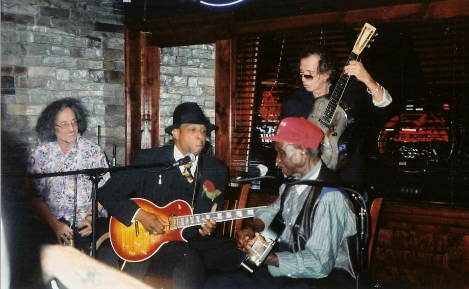Rolling Stones guitarist and longtime Fairfield County resident Keith Richards, right rear, jams with Rocky Lawrence, front right, and David Honeyboy Edwards, center, at the Boxcar in Fairfield in 2004. Photo: Contributed Photo / Connecticut Post file photo