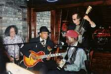 Rolling Stones guitarist and longtime Fairfield County resident Keith Richards, right rear, jams with Rocky Lawrence, front right, and David Honeyboy Edwards, center, at the Boxcar in Fairfield in 2004.