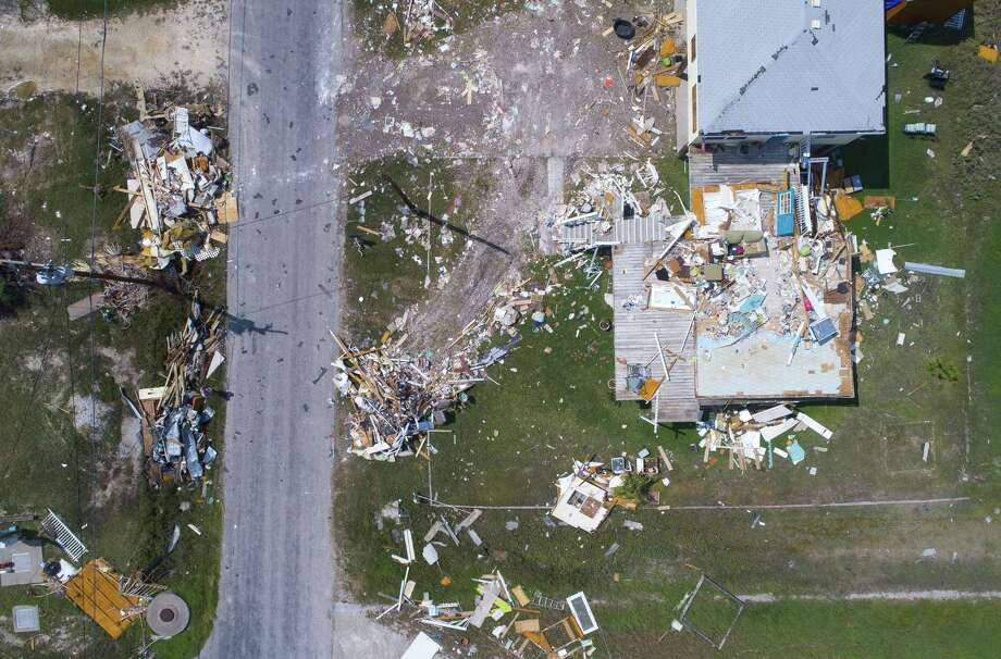 Debris is scattered around a home in Rockport, TX, Wednesday, Sept. 13, 2017. Rockport took a direct hit from Hurricane Harvey on Aug. 25. A new report from Moody's Investors Service warns of higher local government property tax and utility rates in the storm-damaged counties in Southeast Texas because of reduced property valuations and lower utility use. Photo: Mark Mulligan /Mark Mulligan / Houston Chronicle / 2017 Mark Mulligan / Houston Chronicle