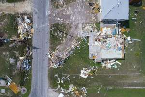 Debris is scattered around a home in Rockport, TX, Wednesday, Sept. 13, 2017. Rockport took a direct hit from Hurricane Harvey on Aug. 25. A new report from Moody's Investors Service warns of higher local government property tax and utility rates in the storm-damaged counties in Southeast Texas because of reduced property valuations and lower utility use.