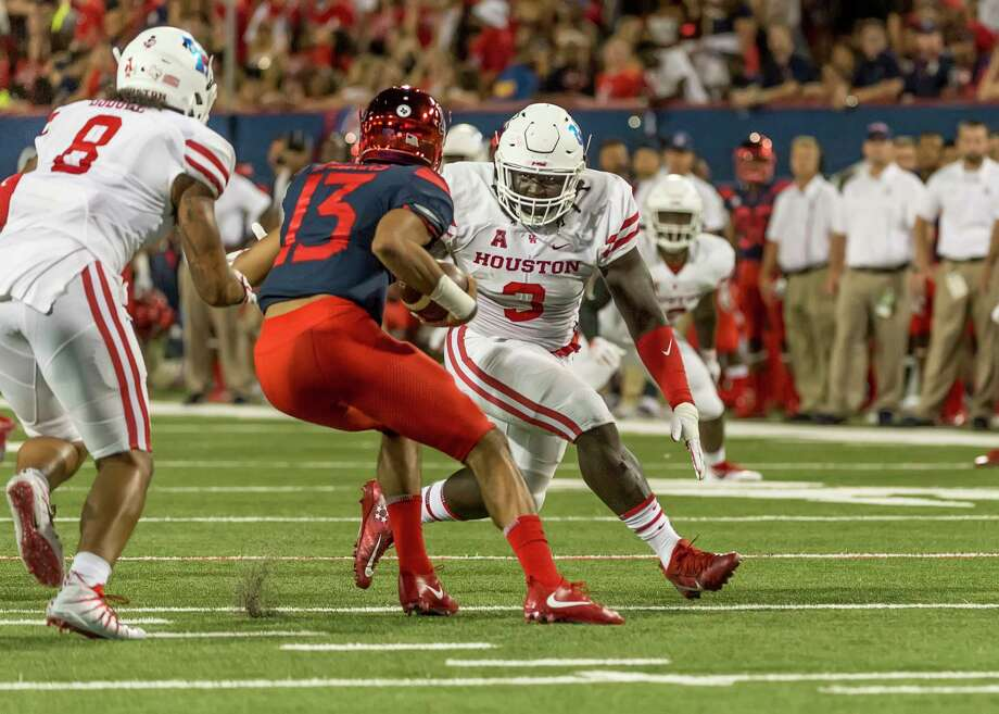 Defensive lineman Reggie Chevis, right, has started both games for UH this season. Photo: University Of Houston / Bert Thomas - OnLocationPhotography - 2017