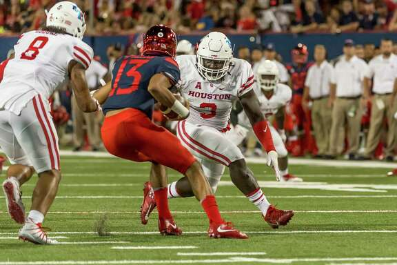 Defensive lineman Reggie Chevis, right, has started both games for UH this season.