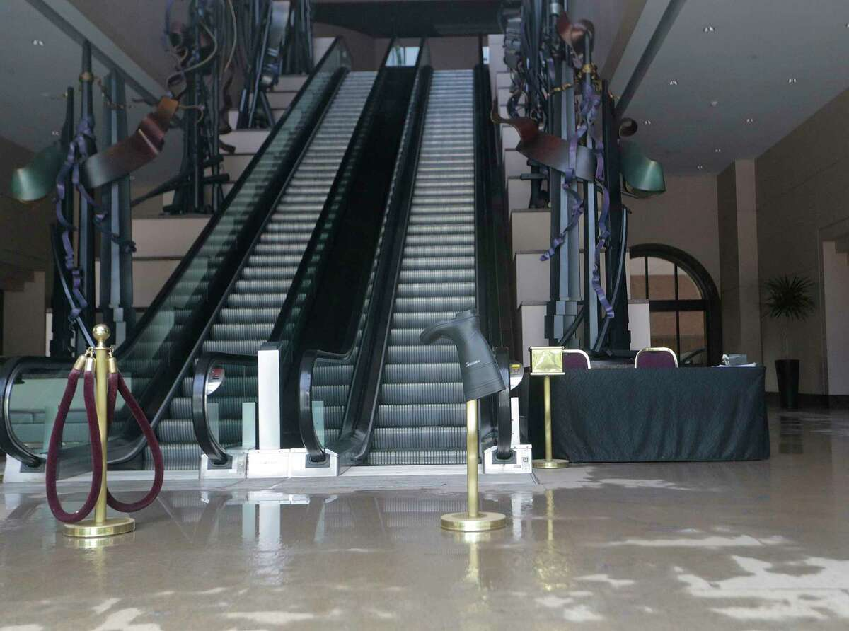A rubber boot sits in the lobby of the Wortham Theater in Downtown Houston. The theater sustain damage from flooding as a result of now-named Tropical Storm Harvey on Monday, Aug. 28, 2017. ( Elizabeth Conley / Houston Chronicle )