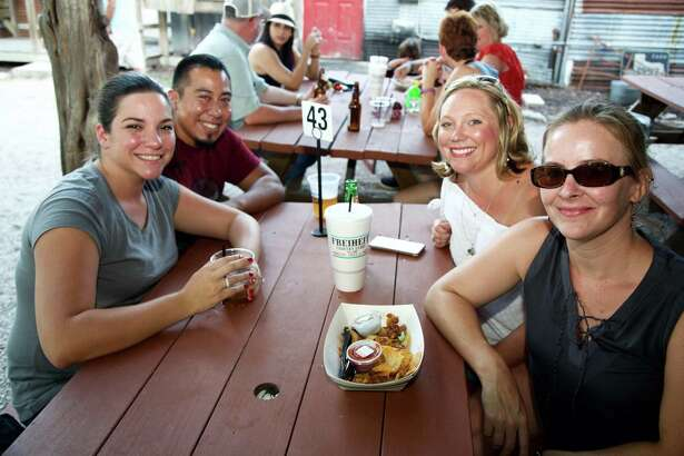 Katie Perez, Andrew Perez, Abby Dunivan, and Kassy King gather on the patio at Freiheit Country Store.