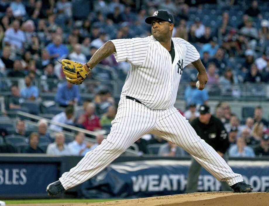 New York Yankees pitcher C. C. Sabathia works against the Boston Red Sox during the first inning of the Yankees' 6-2 win Thursday. Photo: Craig Ruttle — The Associated Press  / FR61802 AP