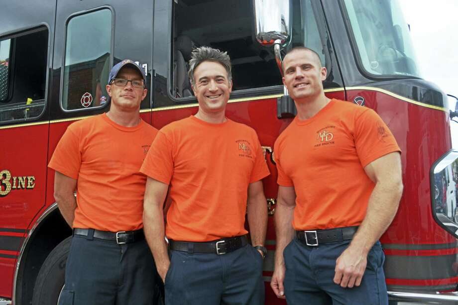 From left, firefighters Paul Brann, Dan Caneveri and Lt. James Ehman are shown at the Middletown Fire Department's Main Street station. Ehman, along with 11 other firefighters, including his twin brother Pat, posed for the 2018 MARC Community Resources calendar, which will be sold for $20 at the Tip-A-Firefighter Oct. 13 at Tuscany Grill on Court Street. Photo: Cassandra Day / Hearst Connecticut Media