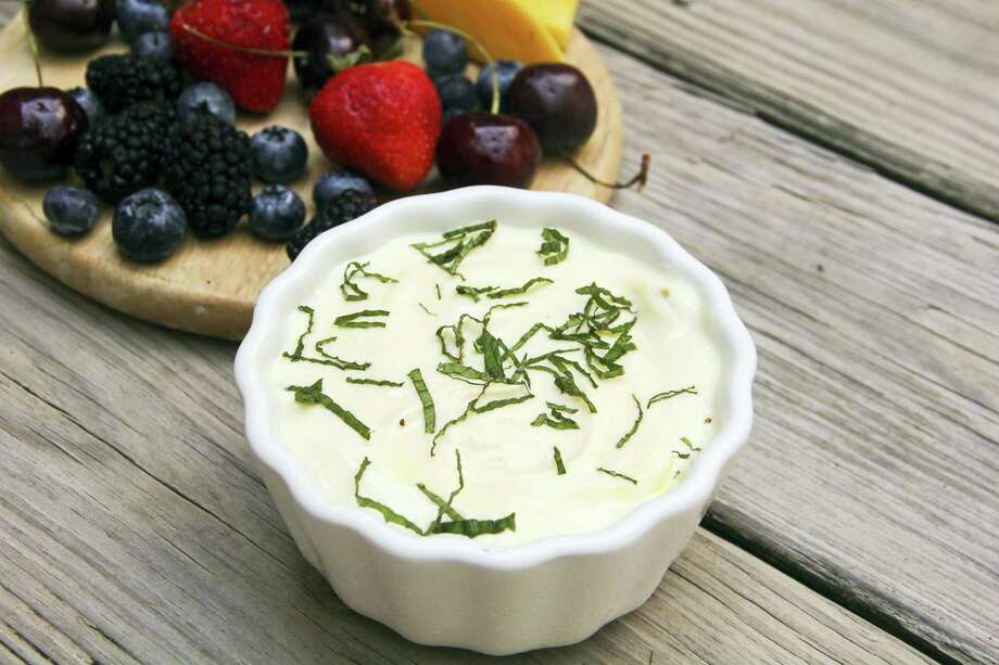 Tangy orange fruit dip with fresh mint from a recipe by Melissa d'Arabian. Photo: Melissa D'Arabian Via AP  / Melissa d'Arabian