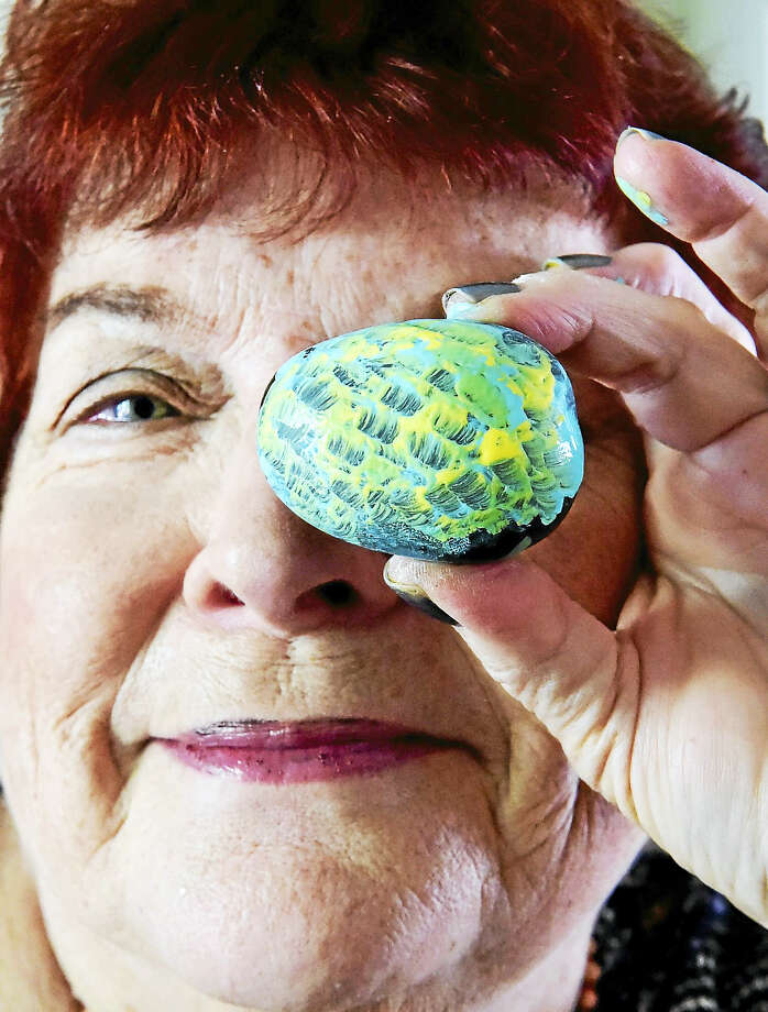 """(Peter Hvizdak /  Hearst Media Connecticut) Guilford, Connecticut: Friday,  September 8,  2017. Libby Wittner-Heintz,  of Guilford, decorates  """"kindness rocks"""" with a design, a positive word, or a saying to encourage and promote kindness, to make people who find the rock smile and fell good. Wittner-Heintz is a member of the Kindness Rock Project and Connecticut Shoreline Rocks. Photo: Hearst Connecticut Media / New Haven Register"""