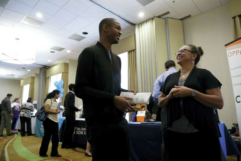 In this Thursday, Aug. 24, 2017, photo, Kathy Tringali, right, a recruiter for Big 5 Sporting Goods, talks to job seeker Jarrell Palmer during a job fair, in San Jose, Calif. On Wednesday, Aug. 30, 2017, the Commerce Department issues the second of three estimates of how the U.S. economy performed in the April-June quarter. Photo: AP Photo/Marcio Jose Sanchez   / Copyright 2017 The Associated Press. All rights reserved.
