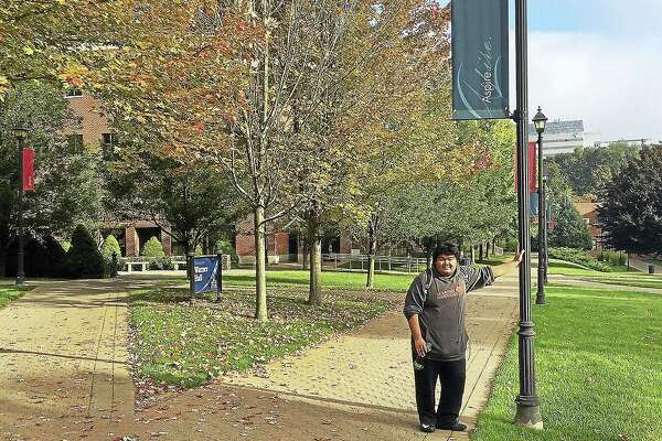 Nielsen Felipe, a freshman at Western Connecticut State University, stands in the school's downtown campus in Danbury on Friday. Felipe said he is being responsible with his spending so far in college.