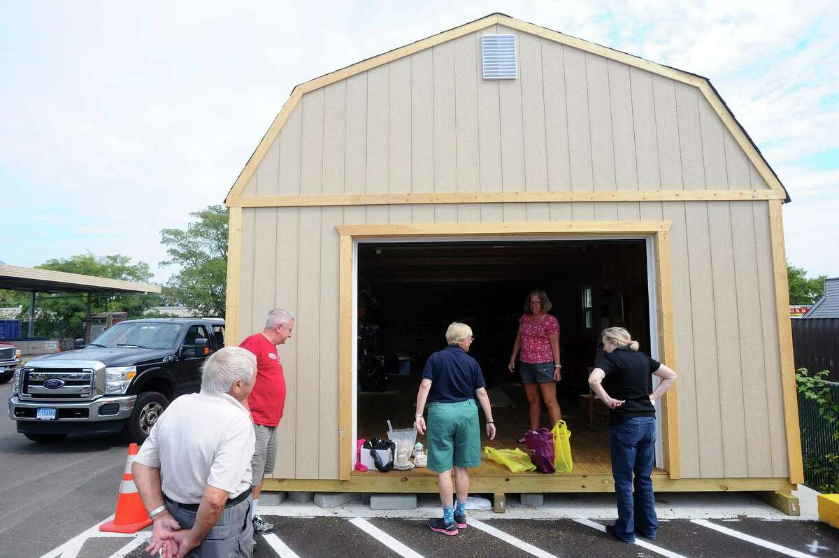 Residents drop off unwanted and unused items for the new swap shop Take It Or Leave It at the Katrina Mygatt Recycling Center in Stamford on Thursday,.