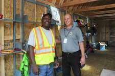 Supervisor Dan Colleluori, center, and operator James Corley pose for a photo inside the new swap shop Take It Or Leave It at the Katrina Mygatt Recycling Center in Stamford, Conn. on Thursday, Sept. 14, 2017. Corley will help run the shop once it opens.