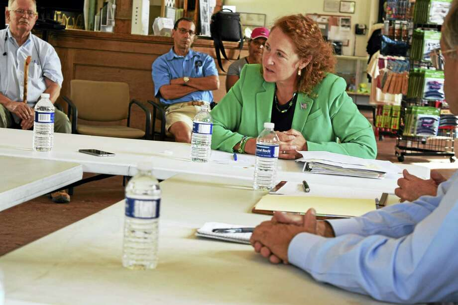 U.S. Rep. Elizabeth Esty, D-5, listens to participants at a roundtable discussion  of freight railroad service in Connecticut at the Railroad Museum of New England in Thomaston. Photo: Contributed Photo